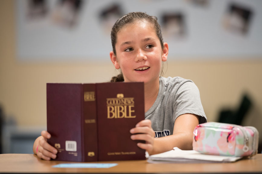 Students reading from Bible