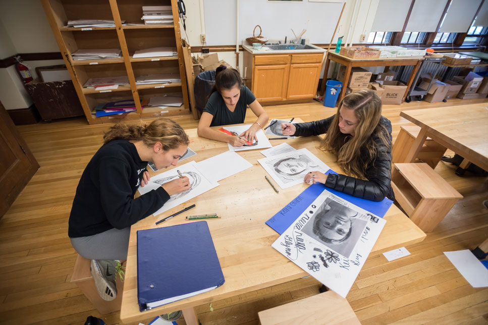 Students drawing in an art classroom