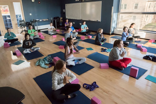 Middle School girls in yoga class in Martin Center